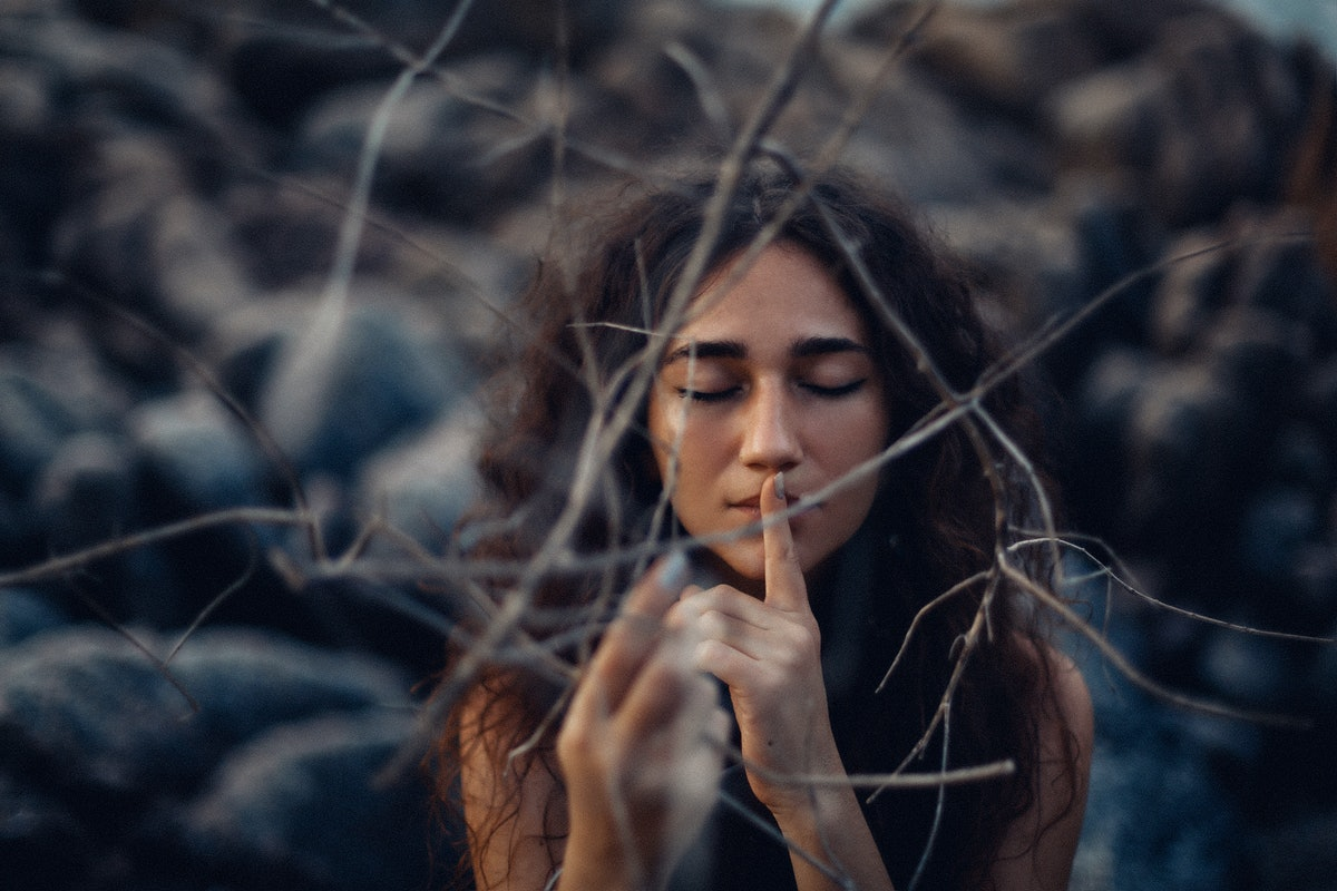 close up of beautiful young woman outdoors. witch craft concept
