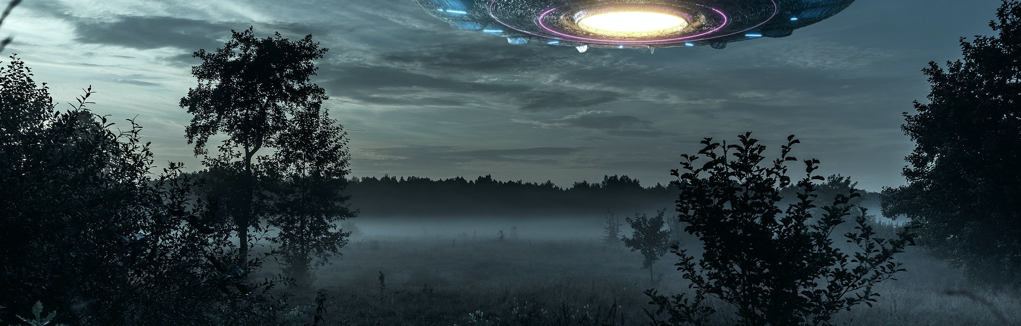 UFO, an alien plate hovering over the field, hovering motionless in the air. Unidentified flying obj...