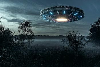 alien over forest landscape