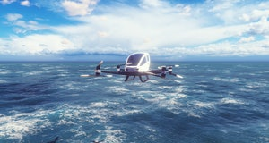 An unmanned passenger air taxi flies over the sea. The concept of the future driverless taxi. 3D Rendering