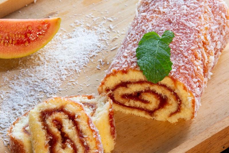 Bolo de Rolo (Swiss roll, Roll cake) typical Brazilian dessert, from the northeast region. Sliced ...