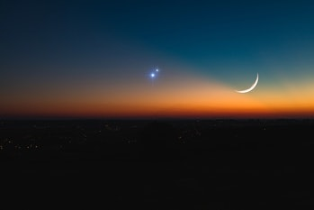 Astronomical conjunction of Saturn, Jupiter and Moon.