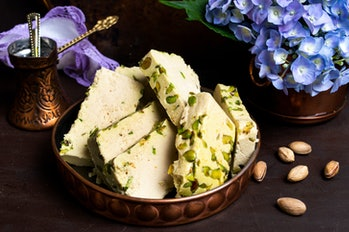 halva on a plate with flowers and nuts