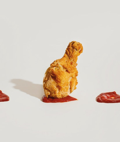 Fried chicken leg with ketchup