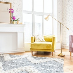 Scandinavian style apartment interior. bright yellow blue colors. wooden flooring. sunlight in large windows.
