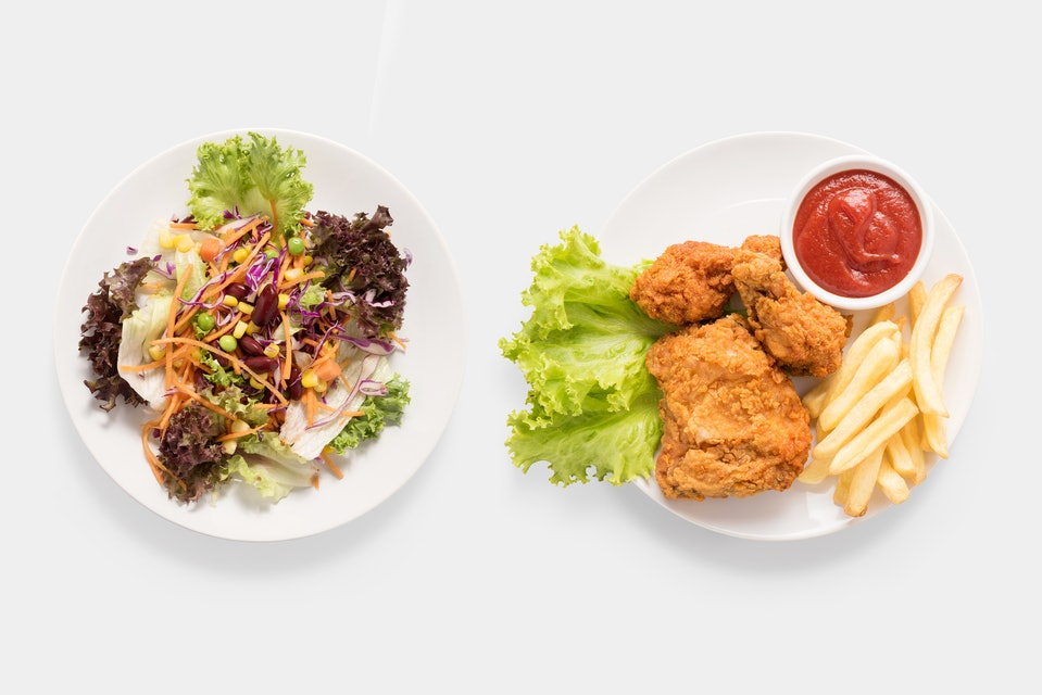 Concept of mock up fresh salad and Fried chicken and french fries set isolated on white background. Clipping Path included on white background. Contrasting food.