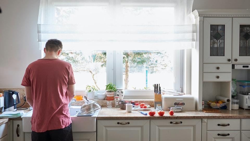 man washing dishes/husband doing housework