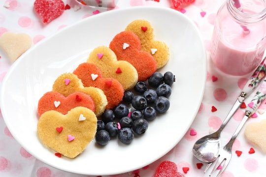 Heart pancakes with strawberry milk / Valentine breakfast concept