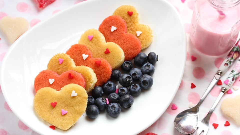 Heart pancakes with strawberry milk / Valentine breakfast concept
