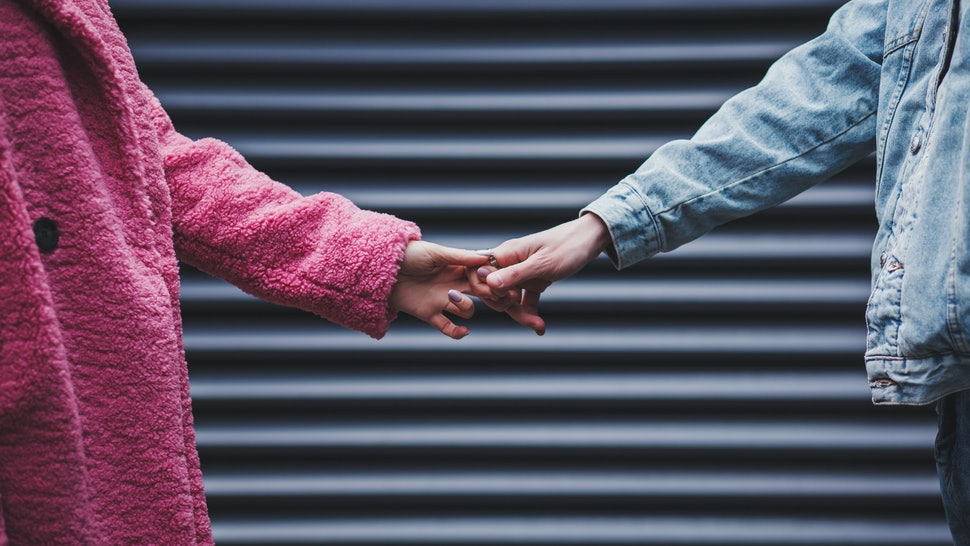 couple holding hands on Valentine's day. concept of love