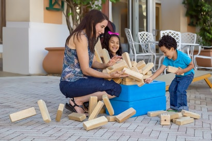 The jumbling tower falls apart while everyone is laughing and trying to keep it from going everywher...