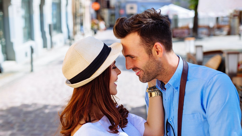 Couple hugging on city street during summer vacation