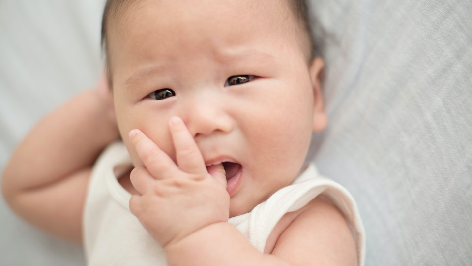 Baby sucking finger