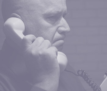 Image with a Disappointed Businessman Making a Phone Call