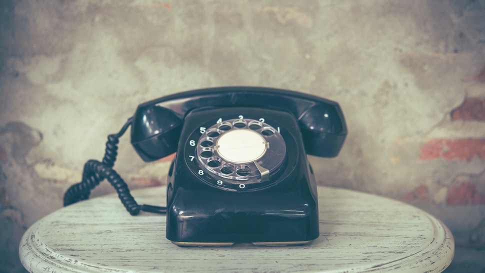 Old telephone with dust and scratches with vintage background, retro style concept