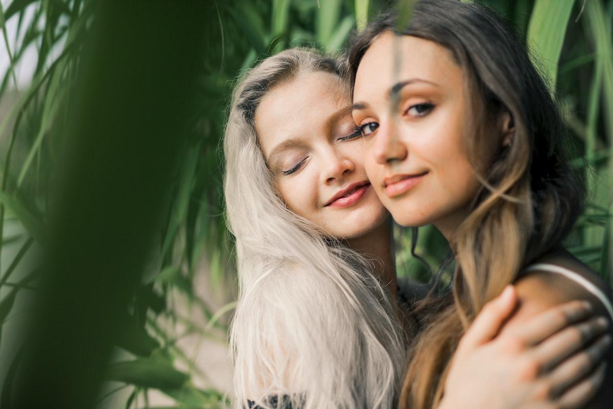 Girls hugging under the leaves