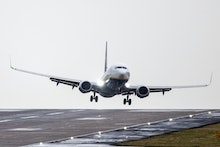 A Ryanair aircraft arriving from Gdansk struggles to land in strong winds at Leeds Bradford airport ...