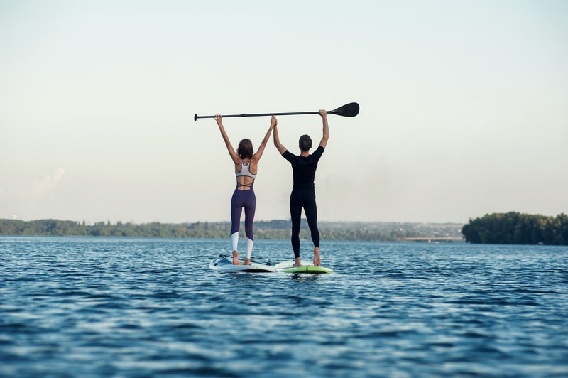 Stand up paddleboard beach people on paddle board