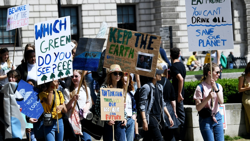 School students walk out in global climate strike, Parliament Square, London.