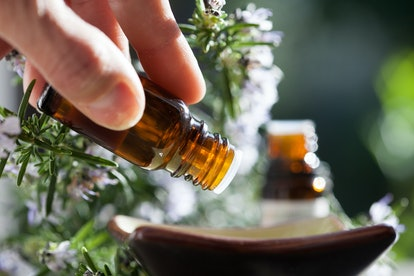 pour rosemary essential oil in a bowl