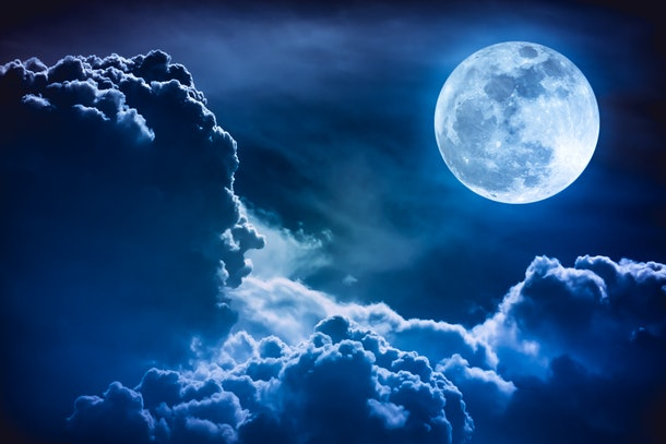 Super moon. Attractive photo of background night sky with cloudy and bright full moon. Nightly sky with beautiful full moon. The moon were NOT furnished by NASA.