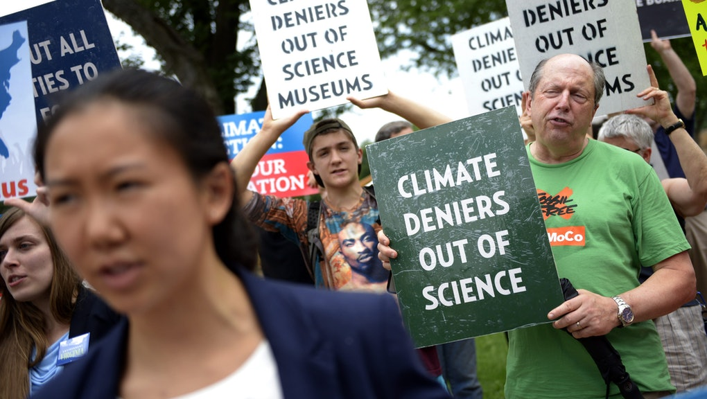 Protesters Chant in Front of the Smithsonian Castle During a Rally Against Board Member David Koch in Washington Dc Usa 15 June 2015 They Called on the Institution to Kick Oil Mogul and Climate Change Denier David H Koch Off of Their Advisory Board and Fire Physicist Dr Willie Soon who Took Over $1 Million From Fossil Fuel Interests in Exchange For Publishing Scientific Reports Denying Human Impact on Climate Change United States Washington