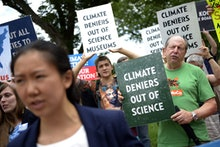 Protesters Chant in Front of the Smithsonian Castle During a Rally Against Board Member David Koch i...
