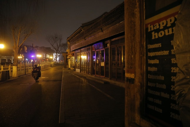 A view shows closed bars at Houhai Bar Street in Beijing, China, 20 February 2020. This Bar Street includes bars, restaurants and cafes and is a good place for local for people and tourists to experience Beijing's nightlife. Most bars, restaurants and cafes along the street are closed due to the Covid-19 coronavirus epidemic.