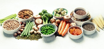 Food sources of plant based protein. Healthy diet with  legumes, dried fruit, seeds, nuts and vegetables.  Foods high in protein, antioxidants, vitamins and fiber. Panorama, banner