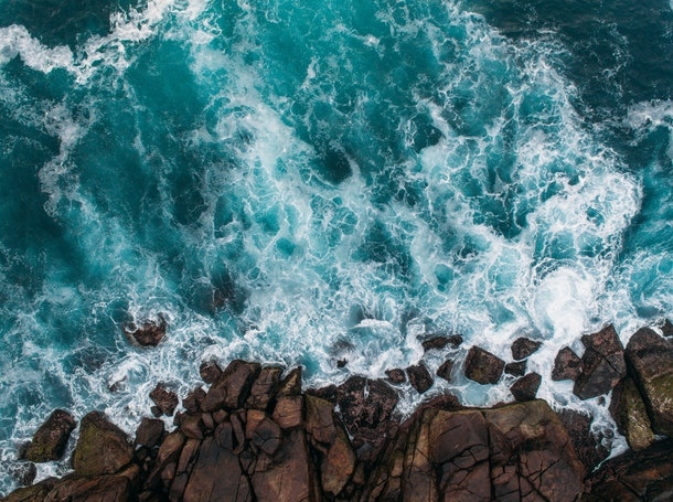 Aerial view of ocean waves and fantastic Rocky coast
