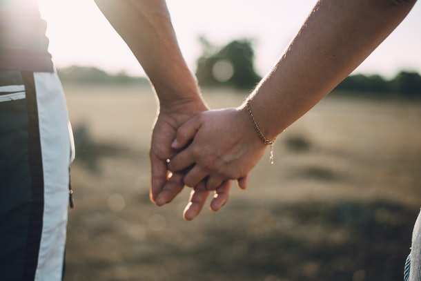 Lovers couple holding hands in a forest. Summer,spring