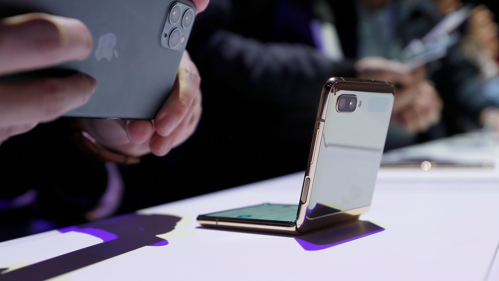 A media member photographs the new Galaxy Z Flip smartphone with his Apple iPhone 11 Pro during the Galaxy Unpacked 2020 event at the Palace of Fine Arts in San Francisco, California, USA, 11 February 2020.
