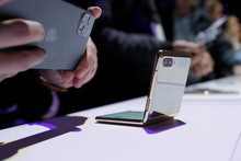 A media member photographs the new Galaxy Z Flip smartphone with his Apple iPhone 11 Pro during the ...