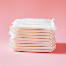 women intimate hygiene products - sanitary pads  on pink background