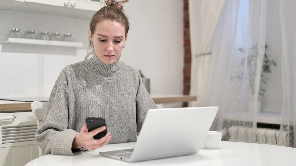 woman on the phone planning for maternity leave