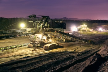 Heavy industrial machine in coal mine in the night