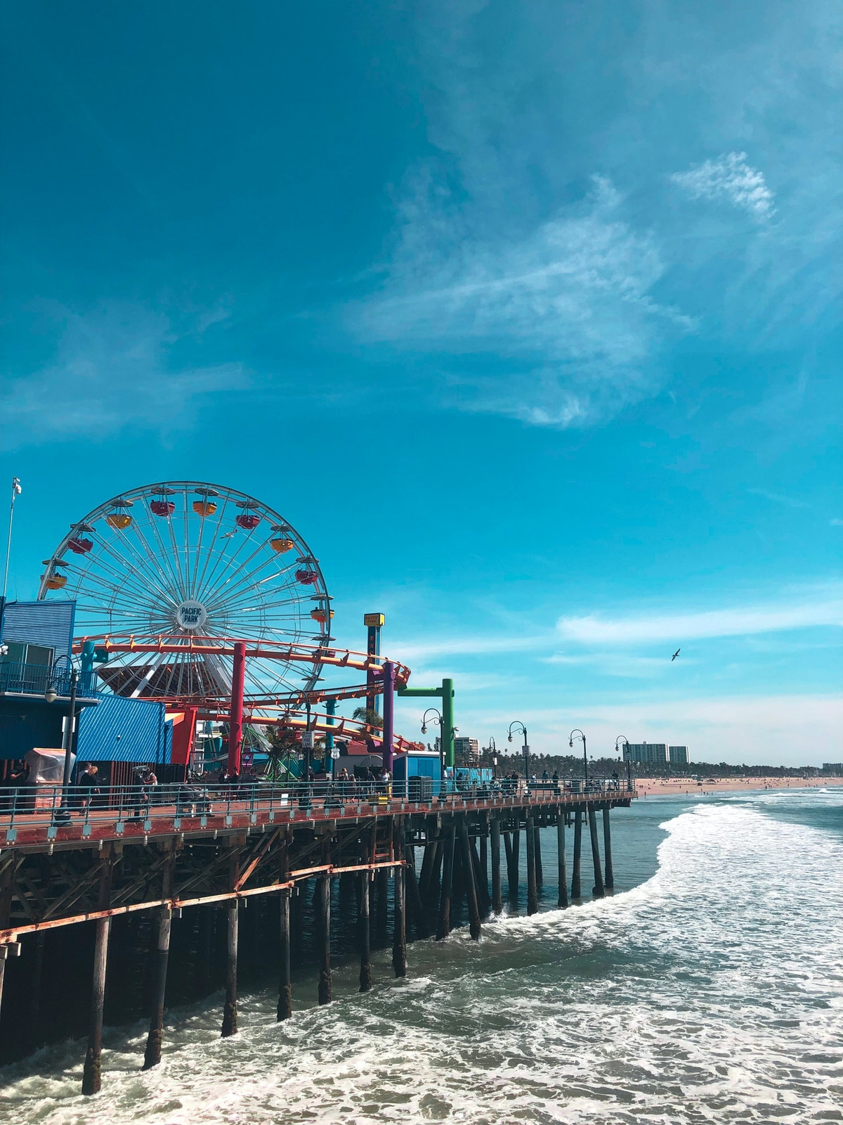 The Santa Monica Pier in California features a carousel, Ferris wheel, and lots of colorful rides on the beach.