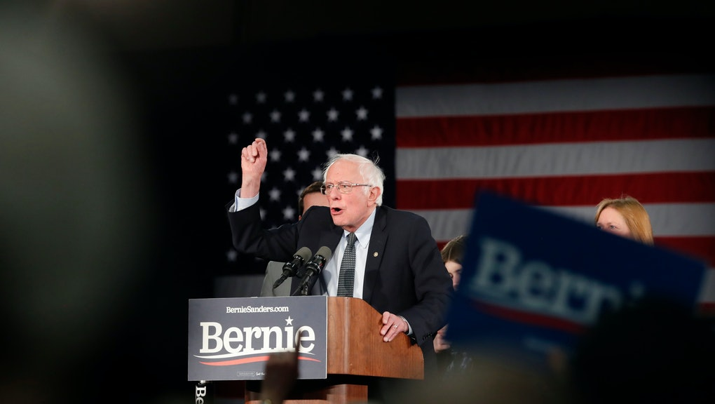 Democratic presidential candidate Sen. Bernie Sanders, I-Vt., with his wife Jane O'Meara Sanders, speaks to supporters at a caucus night campaign rally in Des Moines, Iowa