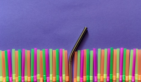 Plastic straws and reusable straw. Zero waste and plastic pollution concept