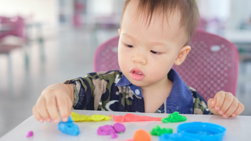 toddler boy playing with play-doh