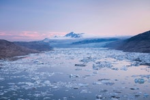 Lake with icebergs, glaciers and mountains at the back, dusk, West Greenland, Greenland