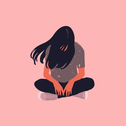 Sad and lonely teenager girl sitting in lotus position on the floor and lowered her head down. Depre...