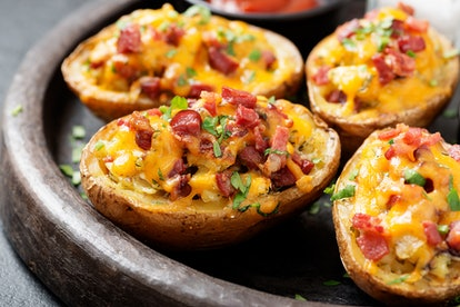 Hot baked potato topped with bacon, green onions and cheddar cheese.