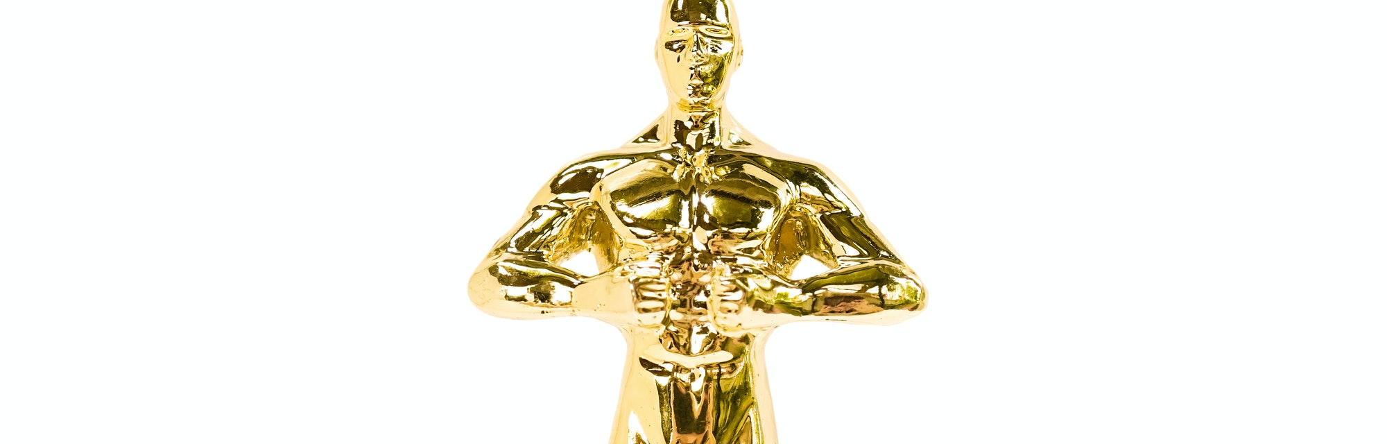 Oscar Golden award or trophy isolated on a white background. Success and victory concept.
