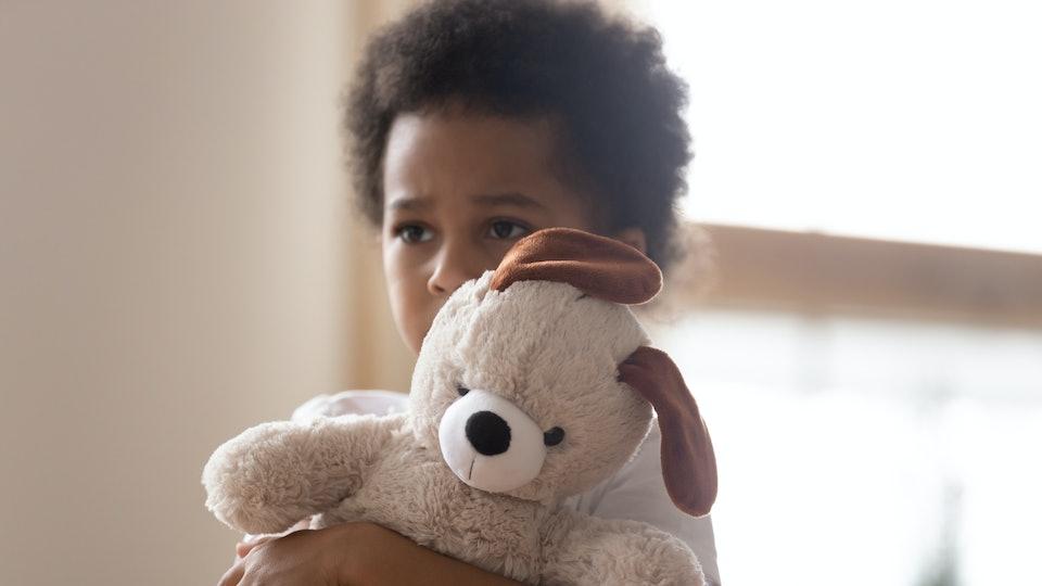 little boy holding a stuffed animal