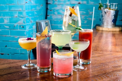 set of Classic alcoholic cocktails on bar counter in pup or restaurant