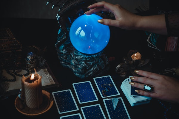 Magic scene, Mystical atmosphere, view of tarot card on the table, esoteric concept, fortune telling and predictions