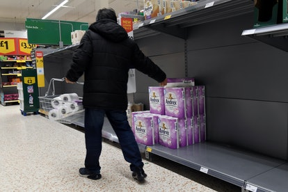 Almost empty toilet paper shelves in Morrisons in Harrow as panic buying continues during the Corona...