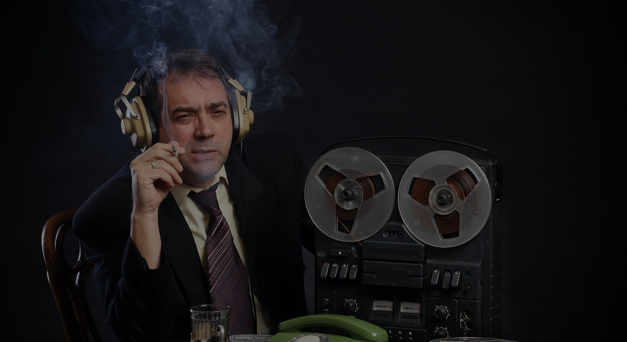 Man in headphones listen to music on record player