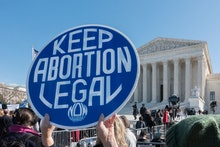 Demonstrators rally in front of the U.S. Supreme Court in support of abortion rights as the court he...